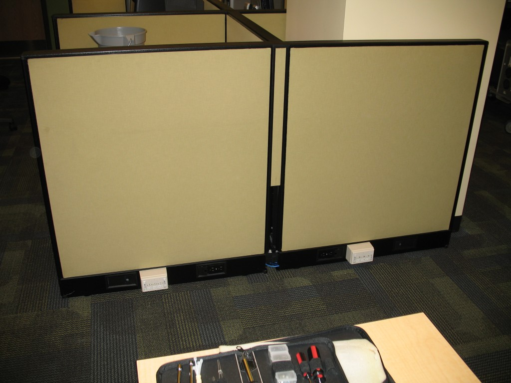 Convergence area with the Ethernet wires nicely tucked back into the remaining cubicles.